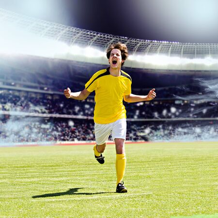 soccer or football player on the field photo