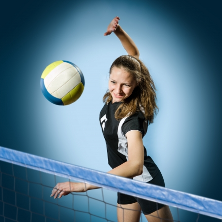 athletic activity: female volleyball player with a ball