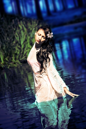 an outdoor portrait of a young woman in the water photo