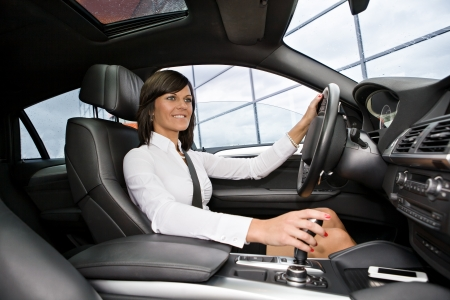a young woman driving a car photo