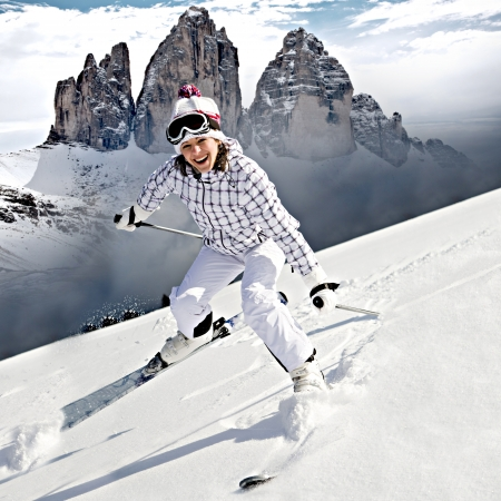 A young woman skiing in the Alps, outdoor shoot. Imagens - 15072915