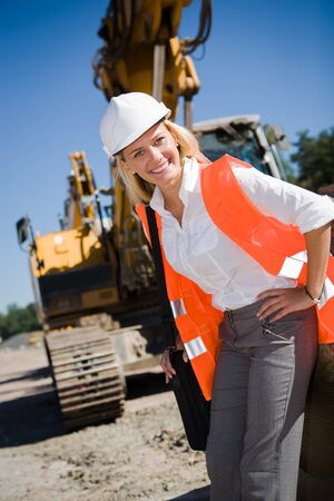 building plans: A young female constructor at building of a neu motorway in Germany