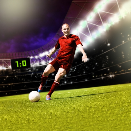 soccer uniforms: two football players from opposing team on the field