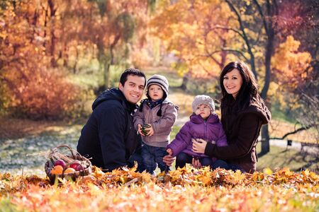 portrait of a young family in the autumn park Stock Photo - 16193917
