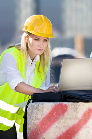 construction plans: A young female constructor at building of a neu motorway in Germany