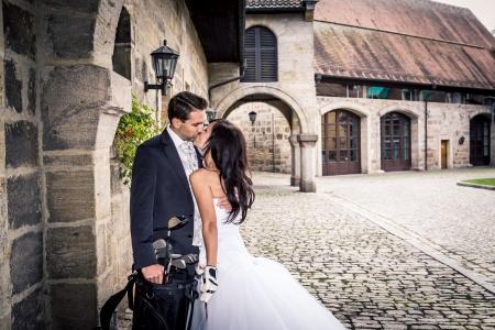 a newly married couple: a newly married couple with golf accessories