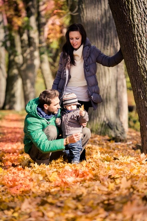 portrait of a young family in the autumn park photo