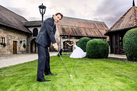 a newly married couple with golf accessories photo