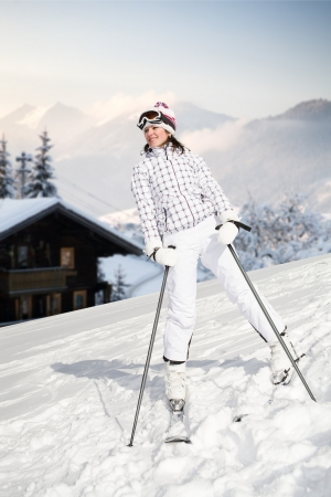A young woman skiing in the Alps. An outdoor shoot. photo