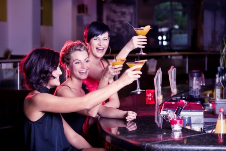 night club: group of young women in the bar