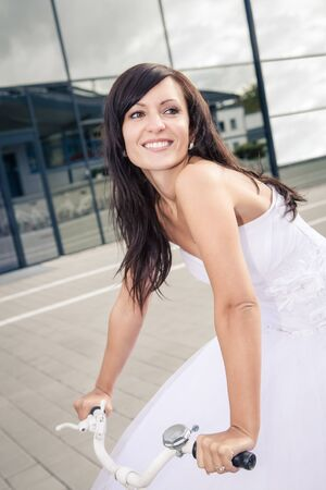 a newly married bride with golf accessories photo