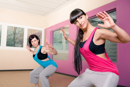 young women in sport dress at an aerobic exercise