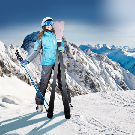 A female skier on the piste in Alps,  Europe. photo
