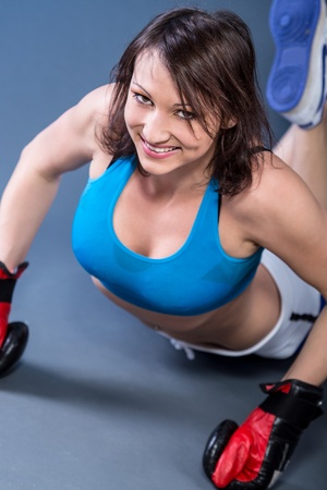 young woman in sport dress at Tae Bo boxing exercise photo
