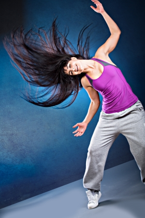 zumba: young woman in sport dress dancing zumba Stock Photo
