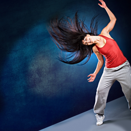 young woman in sport dress dancing zumba Stock Photo