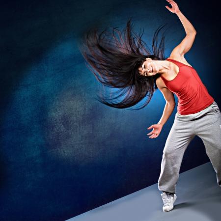 young woman in sport dress dancing zumba Imagens