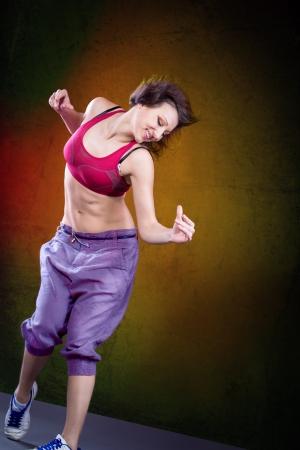 young woman in sport dress dancing zumba Imagens - 18593061