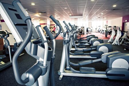 weight room: diverse equipment and machines at the gym room Stock Photo