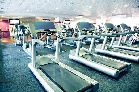 gym room: diverse equipment and machines at the gym room Stock Photo