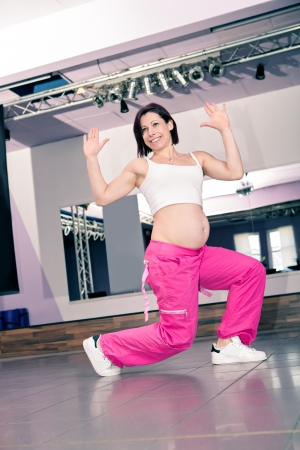 young pregnant woman in sport dress at an aerobic exercise Stock Photo - 18915647