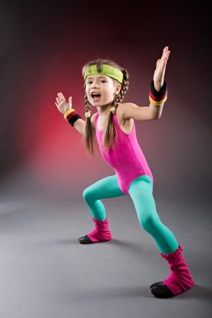 studio shot of a little girl at fitness exercise Imagens - 18915651