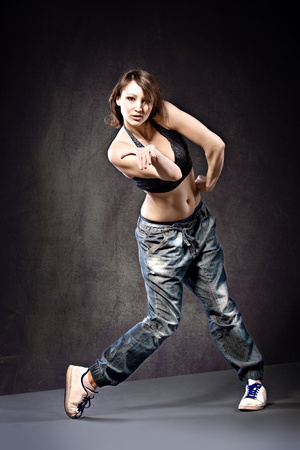 young woman in sport dress dancing zumba photo