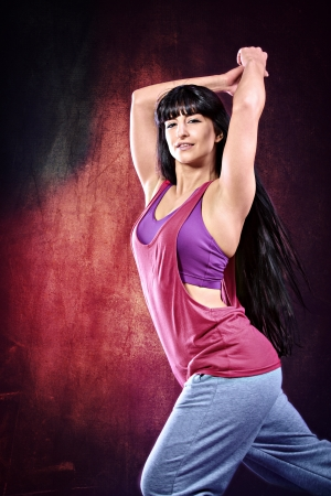 young woman in sport dress dancing zumba Stock Photo - 19203985