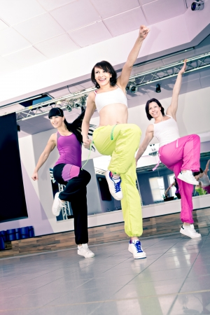 young women in sport dress at an aerobic and zumba exercise Standard-Bild