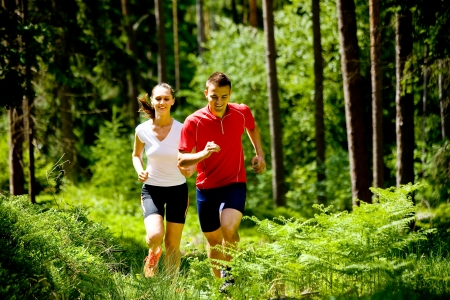 run woman: a couple jogging in forest
