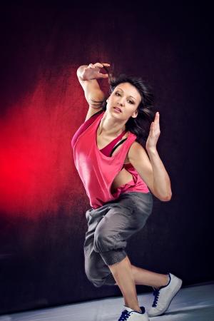 young woman in sport dress dancing zumba Фото со стока