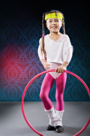 studio shot of a little girl at fitness exercise Stock Photo - 19358459