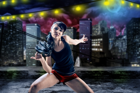 young woman in sport dress dancing in zumba or reggaeton or hiphop style Stockfoto