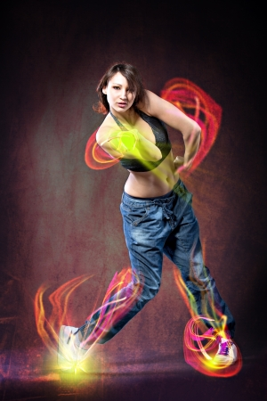 young woman in sport dress dancing zumba Stockfoto