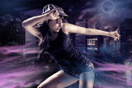 young woman in sport dress dancing in zumba or reggaeton or hiphop style 스톡 콘텐츠