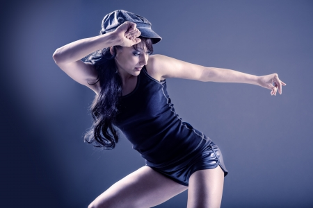 young woman in sport dress dancing in zumba or reggaeton or hiphop style photo