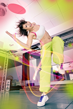 young woman in sport dress at an aerobic and zumba exercise Banque d'images
