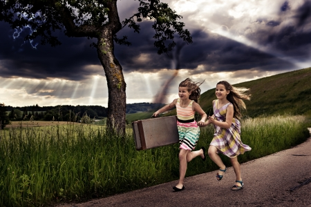 little girls getting themselves to safety from a storm photo