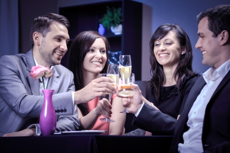 two couples: two couples by eating in a restaurant Stock Photo