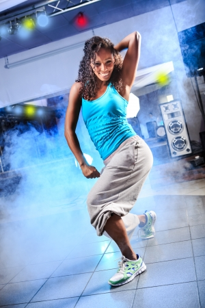 young woman in sport dress at an aerobic and zumba exercise 스톡 콘텐츠