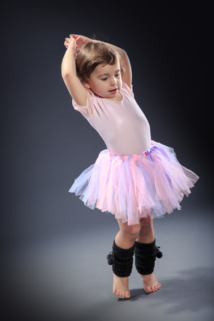 Studio shot of a little girl at dance exercise photo