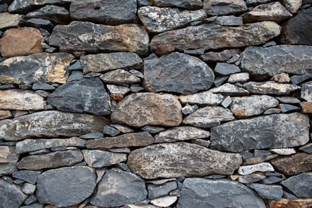 stone wall: close up of a old and cracked stoned wall