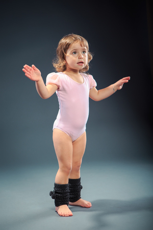 Studio shot of a little girl at fitness exercise photo