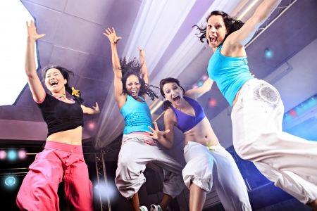 young women in sport dress jumping at an aerobic and zumba exercise Stockfoto