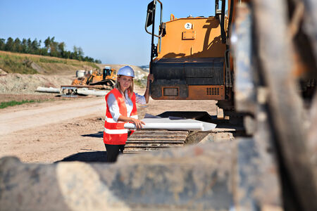 A young female constructor at building of a neu motorway in Germany