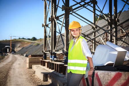 A young female constructor at building of a neu motorway in Germany photo