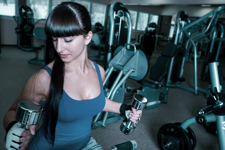 gym dress: young woman in sport dress in a gym room