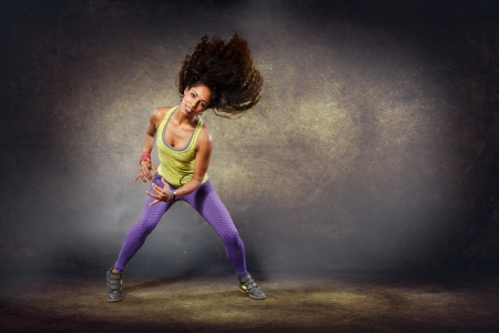 young woman at fitness exercise or zumba dancing Reklamní fotografie - 24663557