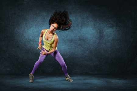 young woman at fitness exercise or zumba dancing