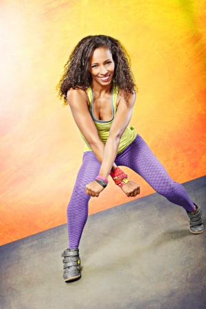 young woman at fitness exercise or zumba dancing photo
